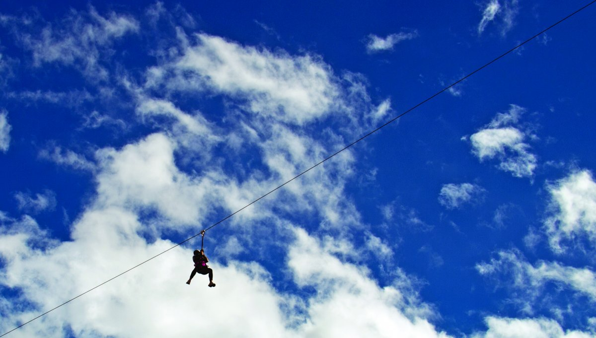 Liz Hilland taking part in a zip slide