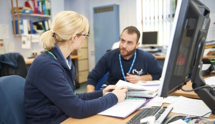 Health professionals working together at desk