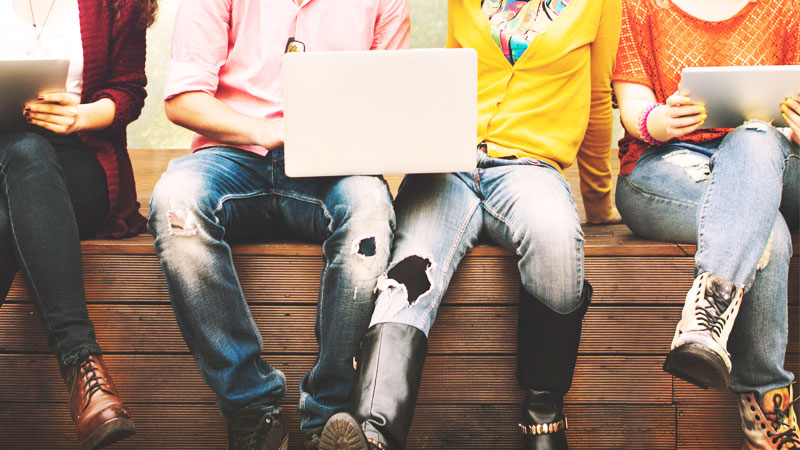 Group of teenagers on a laptop