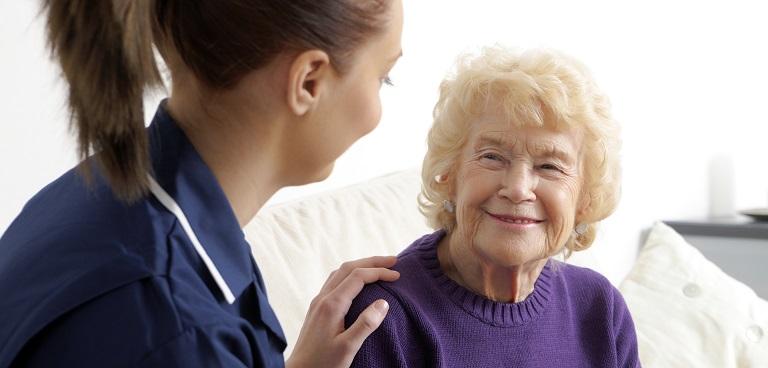 Nurse putting hand on patient's shoulder
