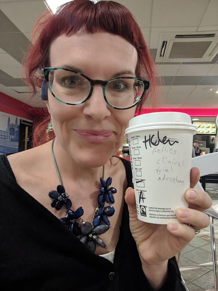 woman with a coffee mug saying Hellie's Clinical Trial adventures