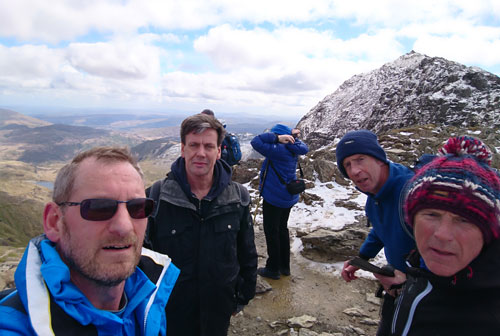 John climbing Snowdon with friends