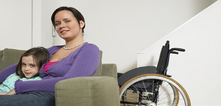parent and child with wheelchair