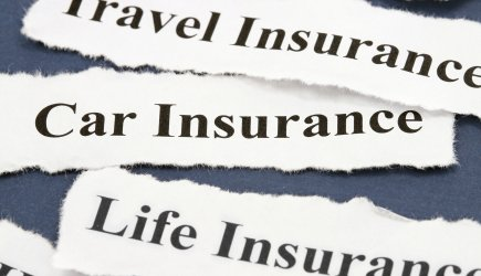 Different kinds of insurance written on paper strips