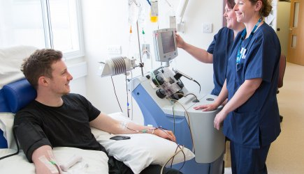 A person with MS receiving an infusion
