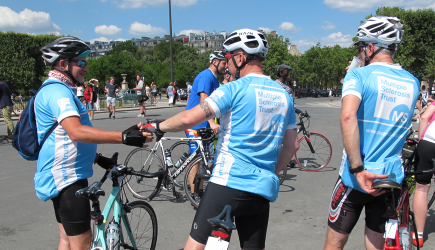 Cyclists shaking hands