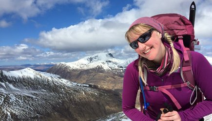 Ginty on top of the Mamores, Ben Nevis in the background