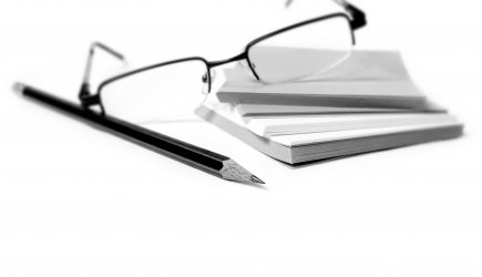 glasses, pencil and notes