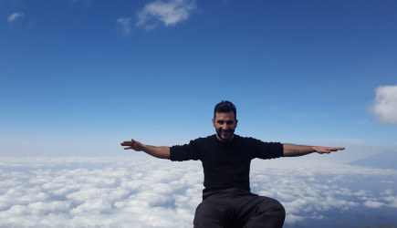 Hasan sitting on the top of Kilimanjaro