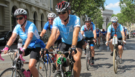 MS Trust riders with Arc de Triomphe in background