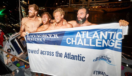 Atlantic Lions with banner at the end of their challenge