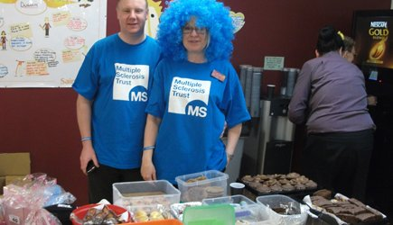 MS Trust fundraisers on a cake stall