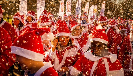 Crowd of Santas in the snow
