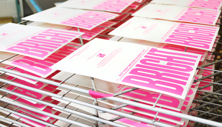 Screen printed cards on a drying rack