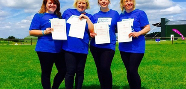 Bessie and Di Baker, Julie Cooper and Yvonne Tizzard with skydive certificates
