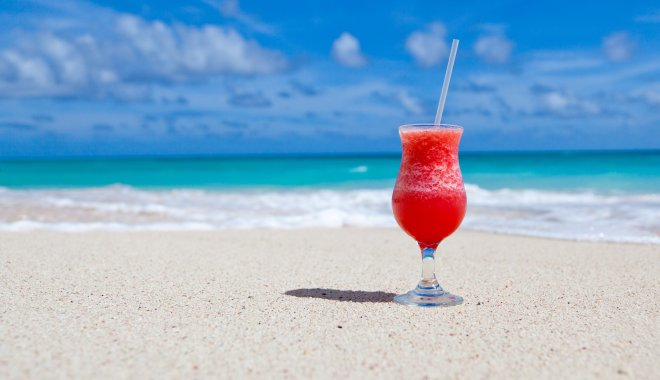 Red icy drink on beach