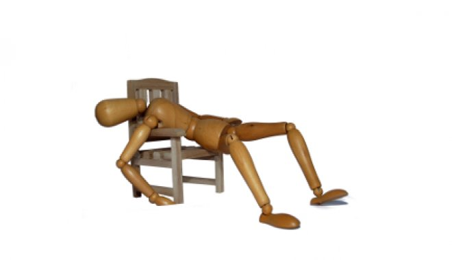 Wooden doll lying back with exhaustion