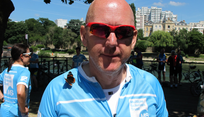 Dave in his MS Trust cycle top with a butterfly on his shoulder