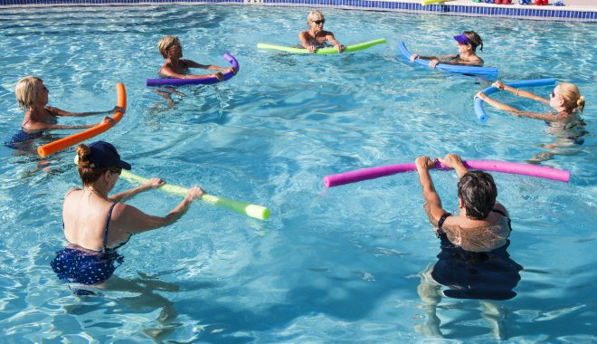 Group of people taking part in an aqua aerobics class in a pool