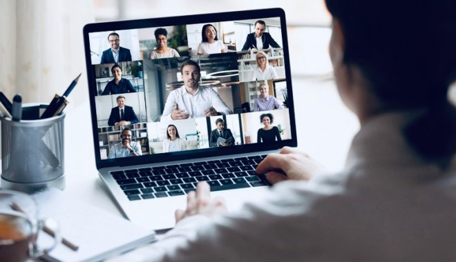 Lady taking part in a video conference on her laptop