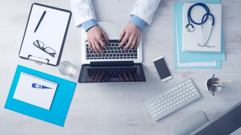 Image of a health professional at their desk