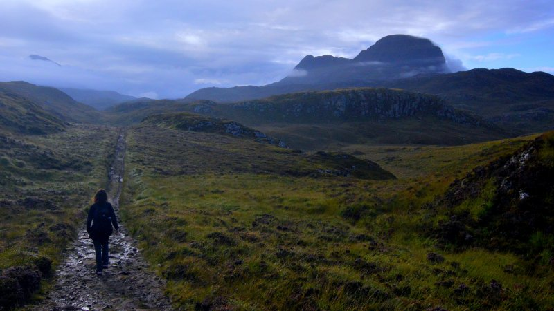 Woman walking in the highlands