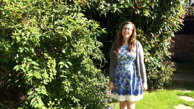 picture of woman standing in garden