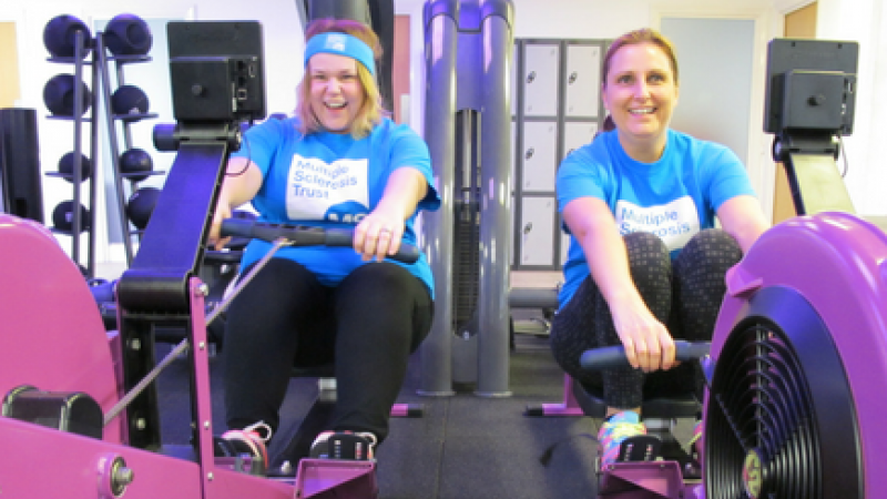 Two ladies on rowing machines for the miles for MS challenge