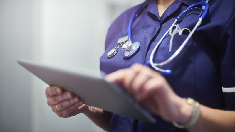 Health professional using a tablet