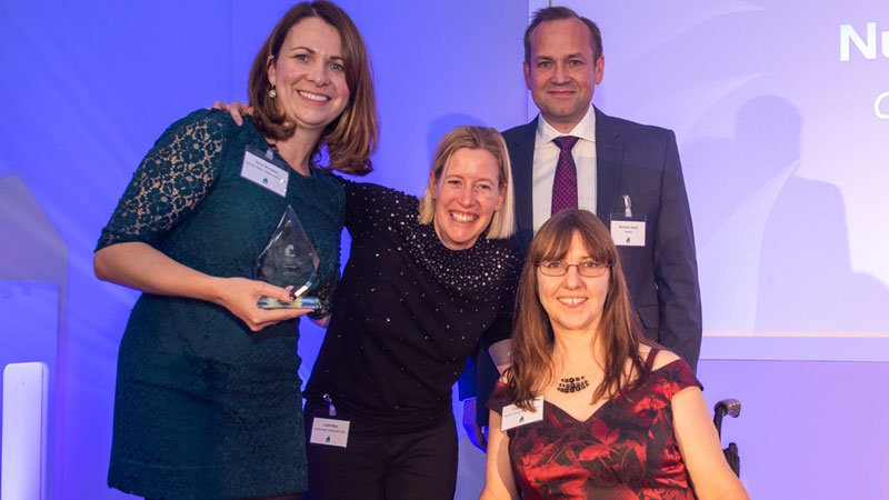 The Chilterns MS Centre nutrition team receiving their award from Richard Jarvis, Novartis