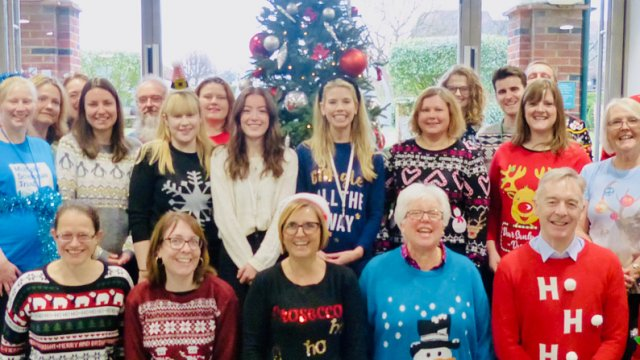 MS Trust staff wearing Christmas jumpers