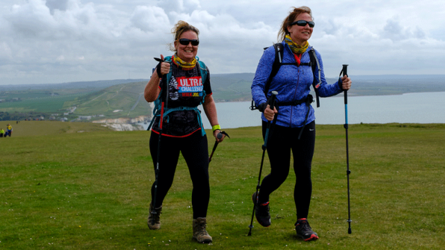 Group of fundraisers hiking by a coastal setting