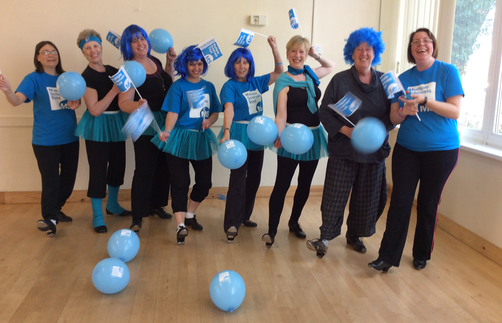 Penny's tap class dressed in  blue