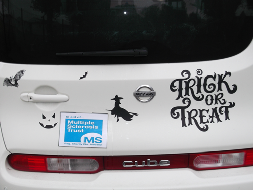 Melissa and Peter's car decorated with Halloween graphics
